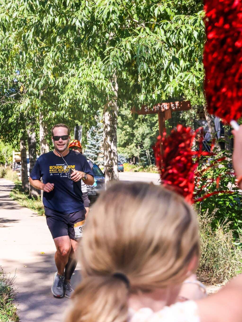 Runners are greeted near the end of the Golden Leaf half marathon on Saturday, Sept. 18, 2021, in Aspen. Photo by Austin Colbert/The Aspen Times.
