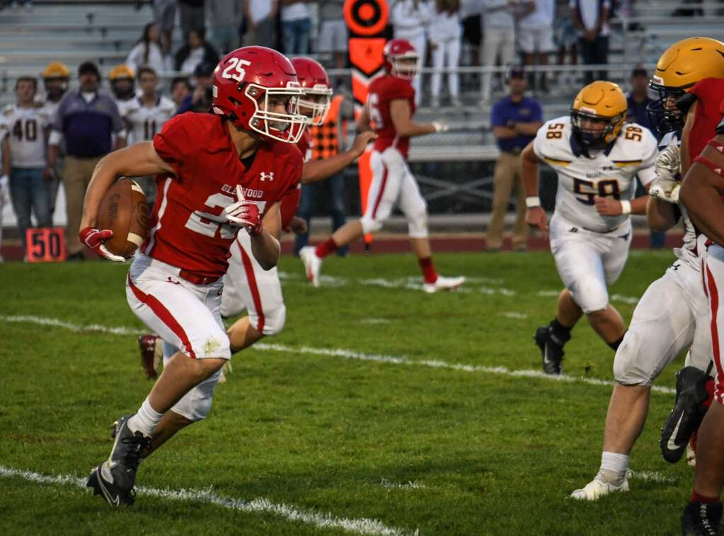 Glenwood Springs Demon Reece Mcmillan looks for an opening in the Basalt Defense during Friday night's game at Stubler Memorial Field. |Chelsea Self / Post Independent