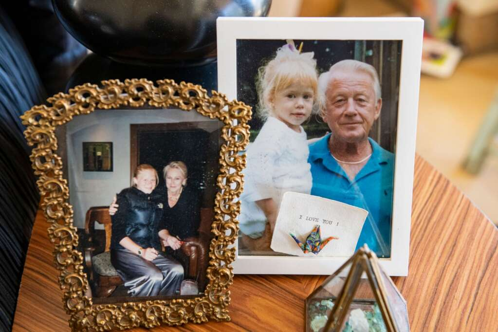 Framed family photos sit on the side table at Jackie Long's home in Aspen on Thursday, Dec. 31, 2020. (Kelsey Brunner/The Aspen Times)