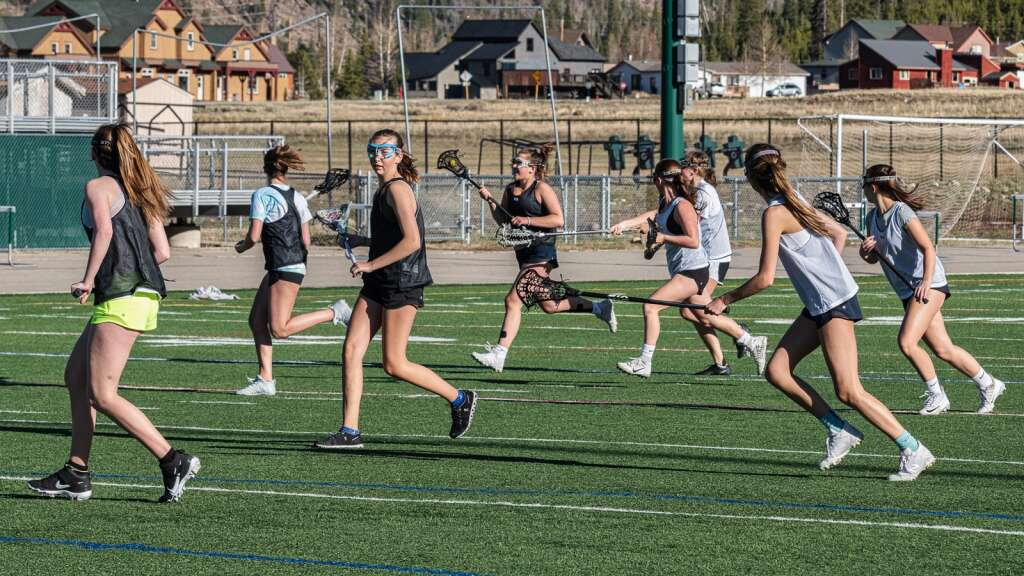 Kallie MacDonald, Catherine Costello, Hailey Hagburg, Zoe Gallup, Lindsay Davis, Chloe Nicholds, Avey Riberdy and Lilian Wiethake practice with the Summit High School varsity girls lacrosse team at Tiger Stadium in Breckenridge on Thursday, May 6, 2021. | Photo by Joel Wexler / Rocky Mountain.Photography