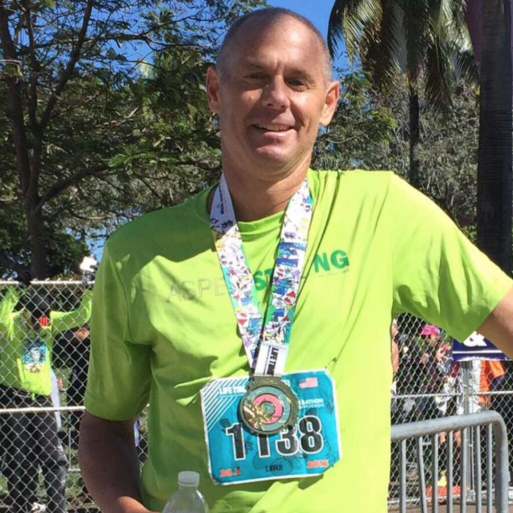 Lawrence Altman poses in an Aspen Strong shirt after completing a marathon in 2014. | Aspen Strong/Courtesy image