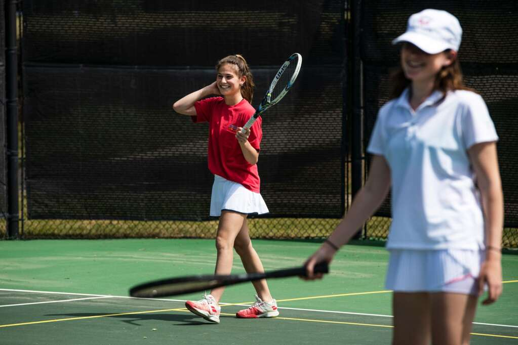 Aspen High School's girls varsity tennis players Lily Citron, left, and Emma Bern run drills during a practice at Snowmass Club on Wednesday, June 9, 2021. (Kelsey Brunner/The Aspen Times)