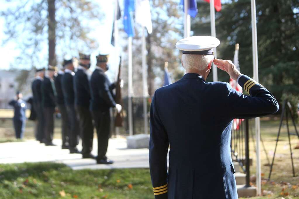 United States Coast Guard retired, Claude Hessel salutes the flag during the playing of taps at the Wreaths Across America ceremony held Dec. 20 at St. Patrick's Cemetery in Grass Valley. | Photo: Elias Funez