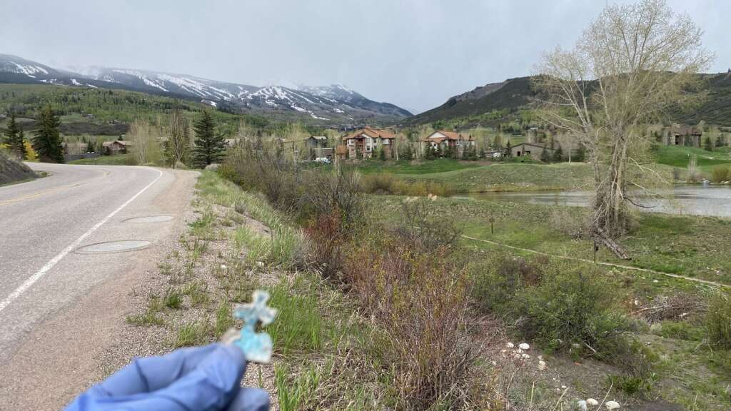 """A lone puzzle piece was one of the """"treasures"""" picked up Friday along Highline Road as part of the annual Snowmass Village Town Clean Up Day. Odd, indeed. (David Krause/The Snowmass Sun)"""