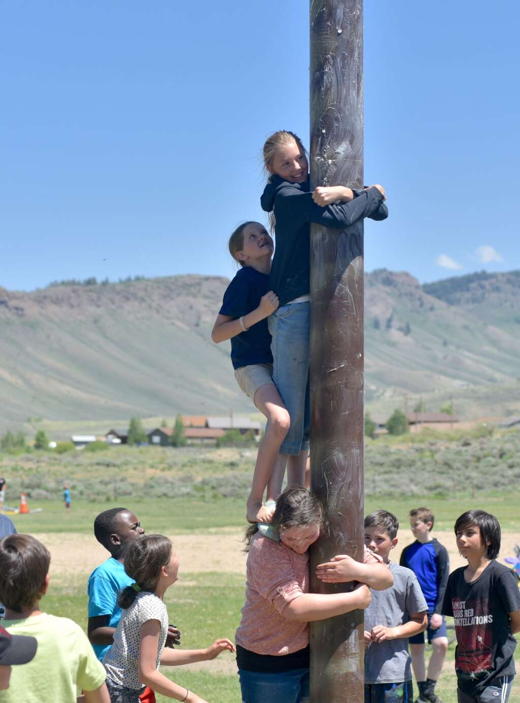 The Grease Pole Contest is a favorite tradition at Hot Sulphur Days. | Amy Golden / agolden@skyhinews.com