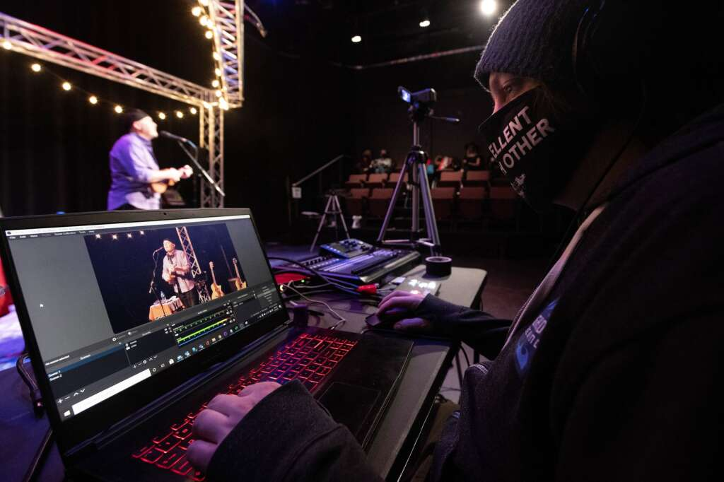 Dustin Schaffer of Top 11 Productions monitors cameras and sound production while filming Kevin Danzig perform a concert at the Silverthorne Performing Arts Center in Silverthorne on Saturday, Jan. 30. | Photo by Jason Connolly / Jason Connolly Photography