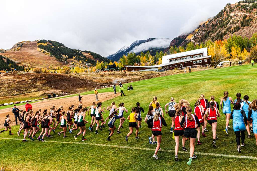 Runners take off from the start of the varsity girls high school cross country race of the Chris Severy Invitational on Saturday, Oct. 9, 2021, near Aspen High School. Photo by Austin Colbert/The Aspen Times.