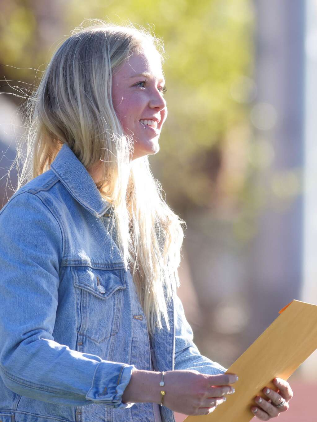Kendall Clark receives her scholarship during  the Aspen High School senior awards and local scholarship ceremony on Monday, May 24, 2021, on the AHS turf field. Photo by Austin Colbert/The Aspen Times.