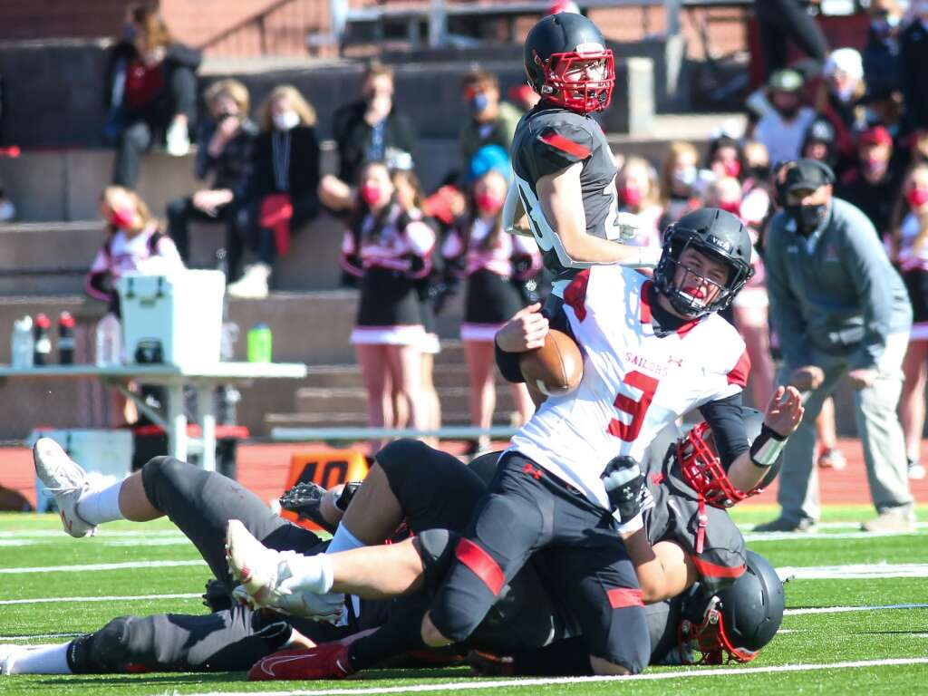 Steamboat Springs quarterback Cade Gedeon is dragged down by an Aspen defender on Saturday, April 10, 2021, on the AHS turf. The Skiers won, 22-7. Photo by Austin Colbert/The Aspen Times.