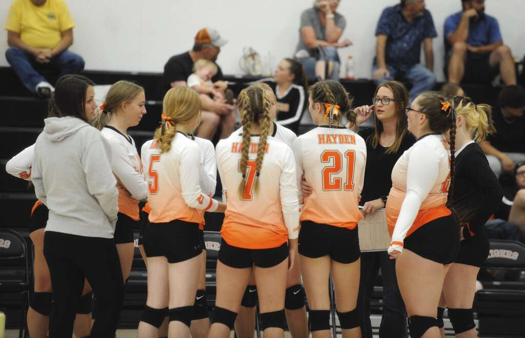 Hayden volleyball head coach Kaitlyn Rudolph talks to her team during a home game against Vail Mountain on Friday night. | Shelby Reardon/Steamboat Pilot & Today