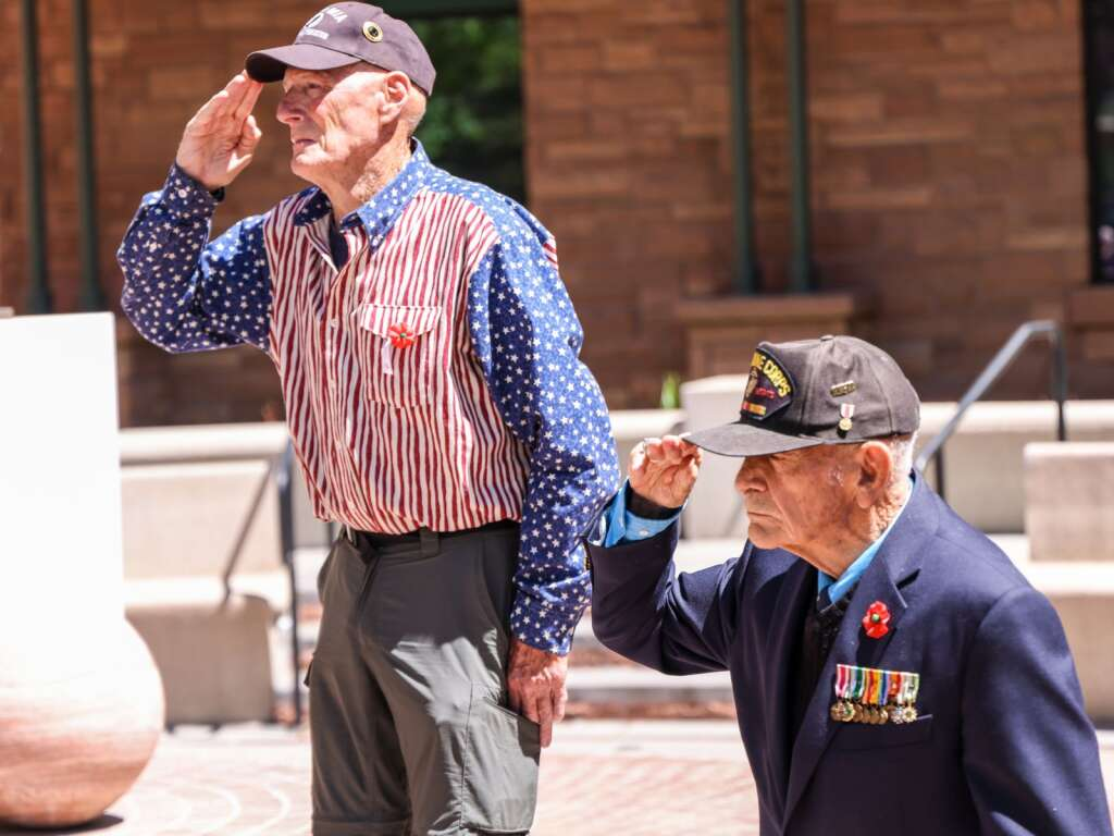 Veterans Dick Merritt, right, and Dan Glidden salute the flag while Taps is played during the annual Memorial Day ceremony on Monday, May 31, 2021, at Pitkin County Veterans Memorial Park in Aspen. Photo by Austin Colbert/The Aspen Times.