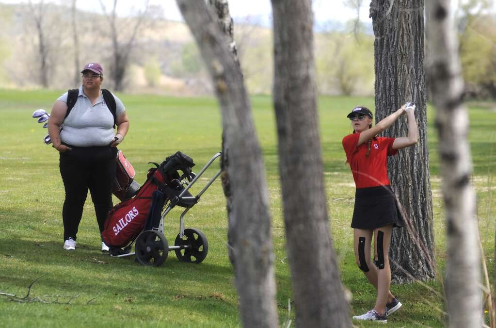 Steamboat Springs golfer Quin Yeager nails an approach shot from behind a group of trees at the Bulldog Invite in Craig on Tuesday afternoon. (Photo by Shelby Reardon)