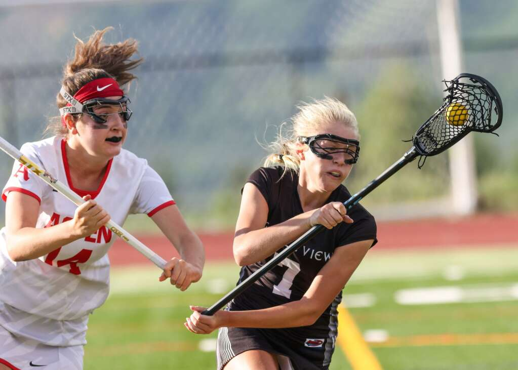 Aspen High School's Mia Seltzer, left, defends in the girls lacrosse game against Castle View in the Class 4A state quarterfinals on Saturday, June 19, 2021, on the AHS turf. The Sabercats won, 10-9. Photo by Austin Colbert/The Aspen Times.