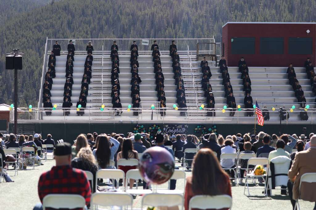 Friends and family watch the Summit High School class of 2021 graduation ceremony Saturday, May 29, in Breckenridge.   Photo by Ashley Low