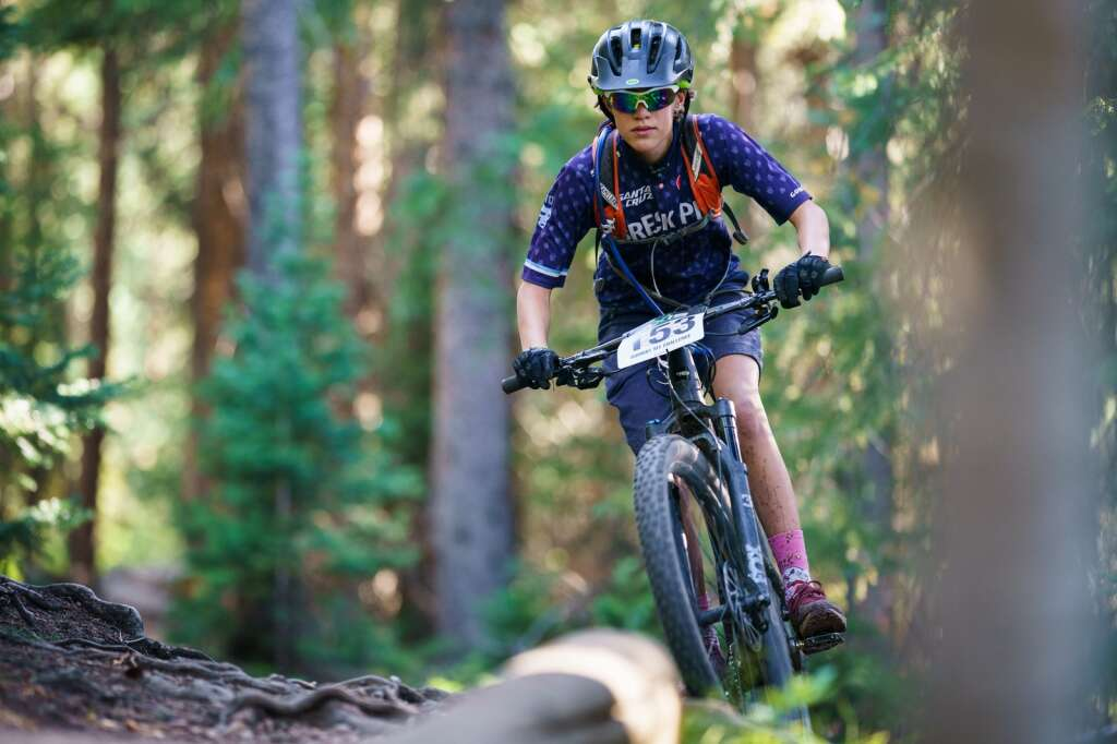 Fiona Florio clears a root filled section of trail on her way to winning the junior girls 13-15 category during the Peaks Trail Time Trial, the sixth round of the Summit Mountain Challenge mountain bike race series. | Photo by John Hanson