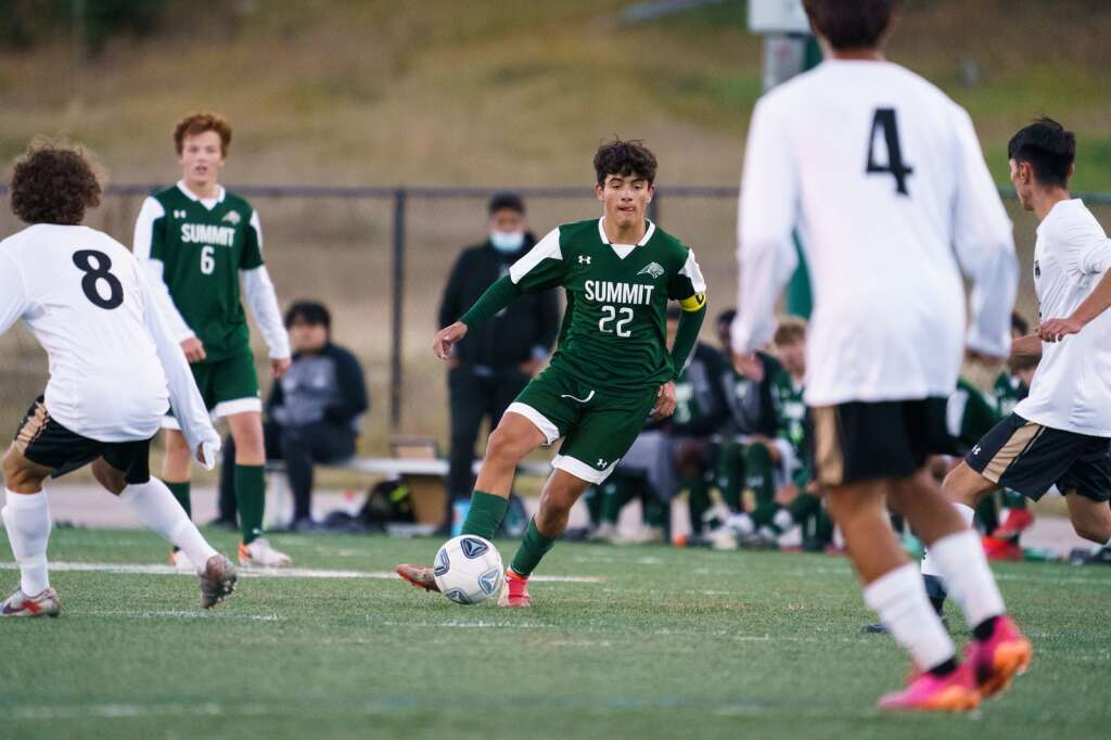 Owen Gallo dribbles through a maze of defenders during the Summit Tigers homecoming match against Battle Mountain on Tuesday, Sept. 21, at Tiger Stadium in Breckenridge. | John Hanson/For the Summit Daily News