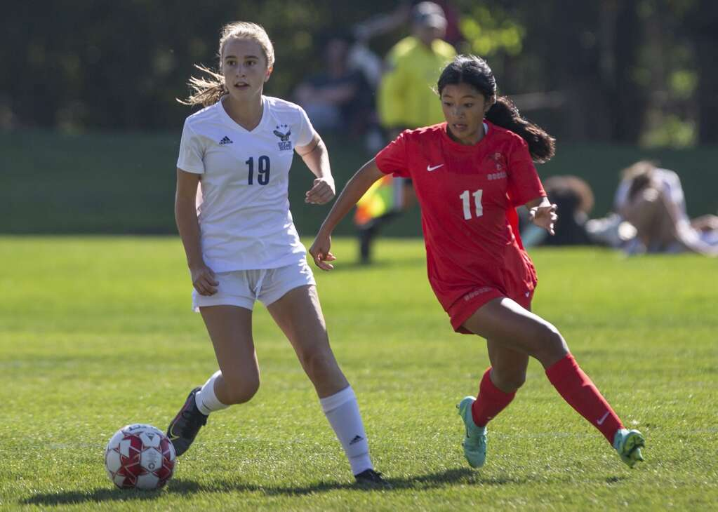 Park City High School's Shelly Palabrica (11) keeps her eye on the ball as the Miners look to shake Skyline High School sophomore Annie Boyden (19) of possession during their matchup at the North 40 playing fields Tuesday afternoon, Sept. 14, 2021. The Miners fell to the Eagles 7-0. (Tanzi Propst/Park Record)