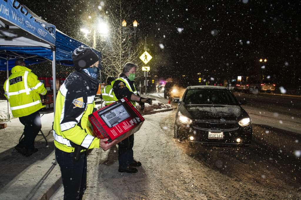 Aspen residents claim heaters outside of the Aspen Police Department to heat their homes during a gas outage on Monday, Dec. 28, 2020. (Kelsey Brunner/The Aspen Times)