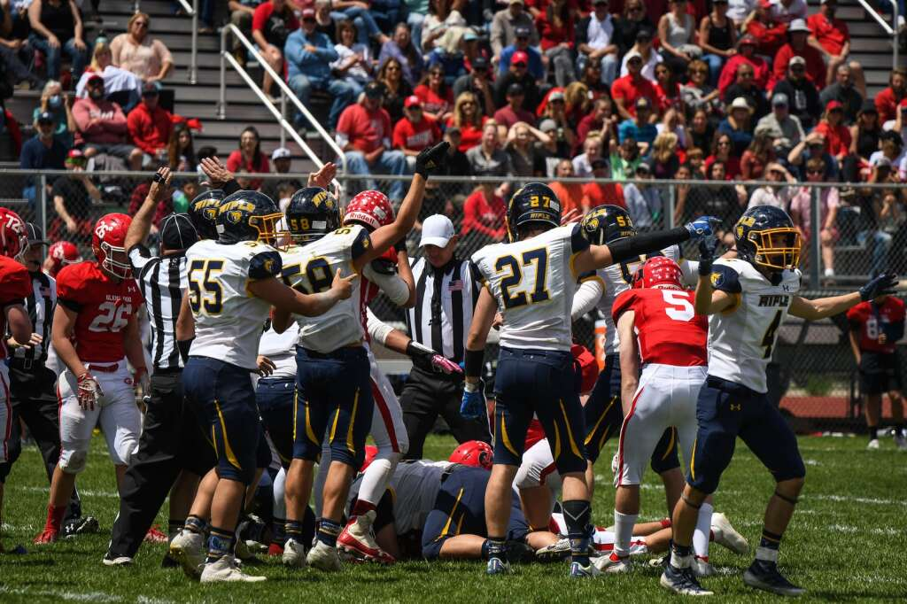 The Rifle Bears react after recovering the ball after the Glenwood Springs Demons fumbled it in the second half of Saturday's state semi-final game.  |Chelsea Self / Post Independent