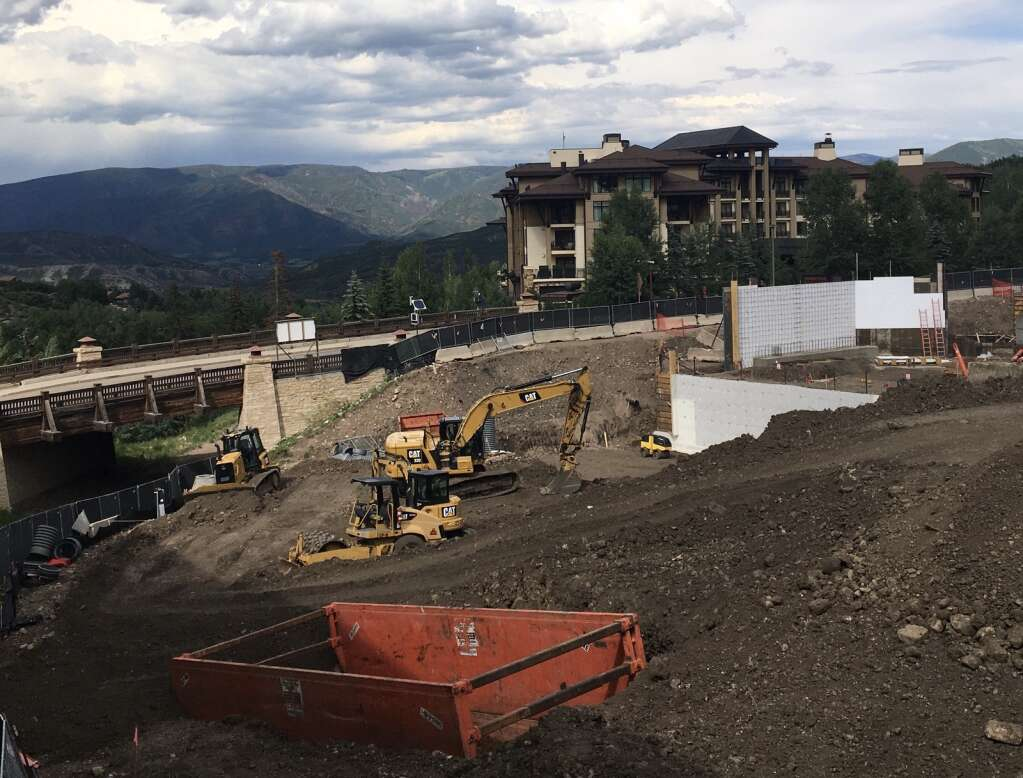 Construction materials and machines populate the site of Electric Pass Lodge, a soon-to-be-built condo building in Base Village, on July 5, 2021. | Kaya Williams/The Snowmass Sun