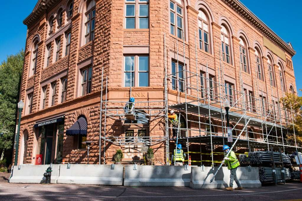 Workers install scaffolding around the Wheeler Opera House building for their restoration project in Aspen on Tuesday, Sept. 22, 2020. (Kelsey Brunner/The Aspen Times)