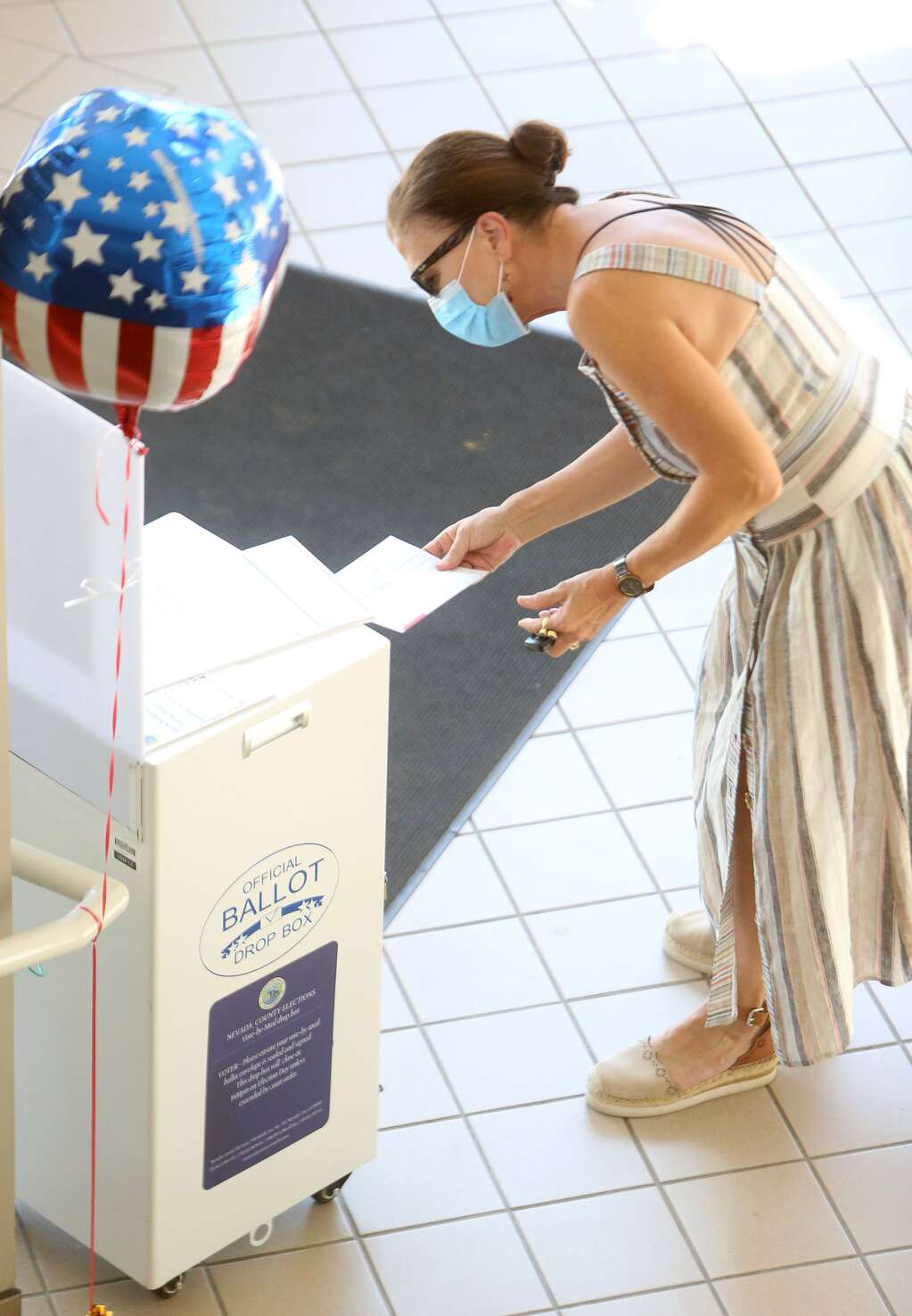 Grass Valley's Lisa Malsam drops her ballot off in the lobby of the Eric Rood Administrative Center Friday morning Oct. 16. | Photo: Elias Funez
