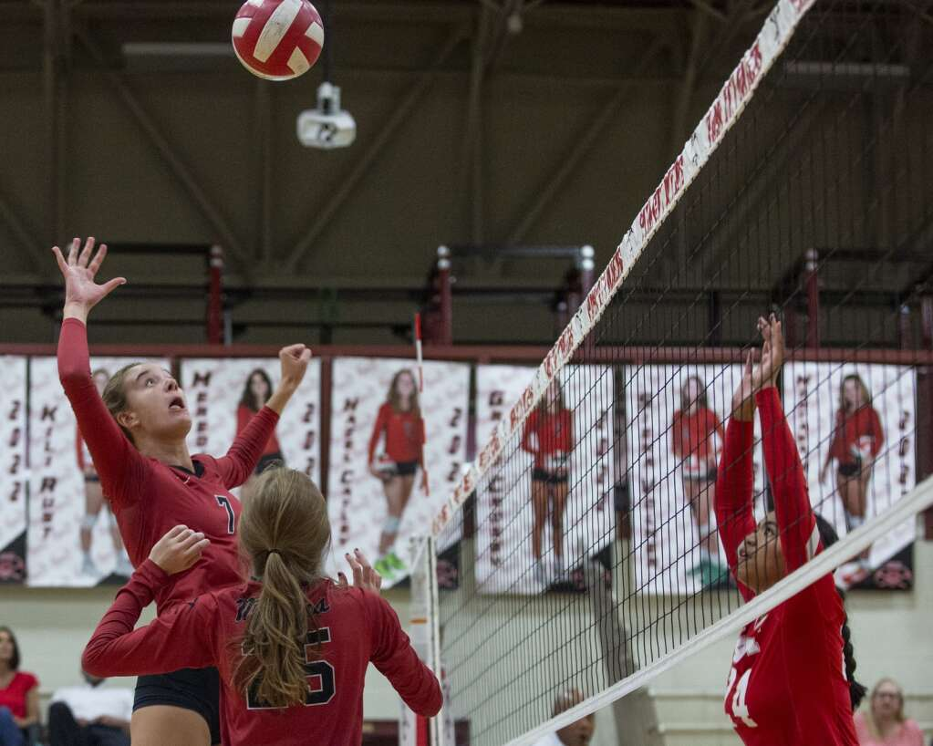 Park City High School senior Grace Crosby (7) spikes the ball over the net during the Miners' matchup against East High School Tuesday evening, Sept. 14, 2021. The Miners swept the Leopards 3-0. (Tanzi Propst/Park Record)