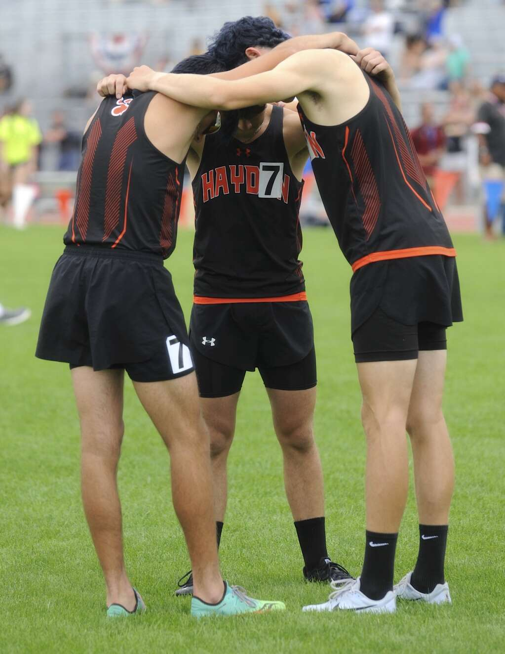 Three members at the CHSAA Track and Field State Championships at JeffCo Stadium on Thursday. (Photo by Shelby Reardon)