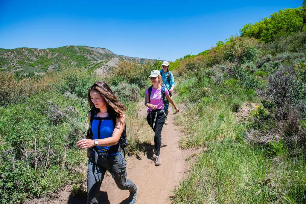 Hikers make their way down Viewline Trail during an afternoon outing through Sky Mountain Park in Snowmass Village on Monday, June 14, 2021. (Kelsey Brunner/The Aspen Times)