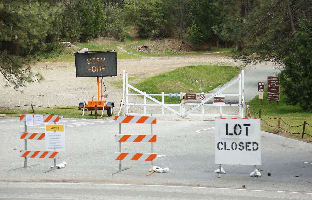 An electronic sign at Empire Mine State Historic Park in Grass Valley tells people to stay home April 11. | Photo: Elias Funez