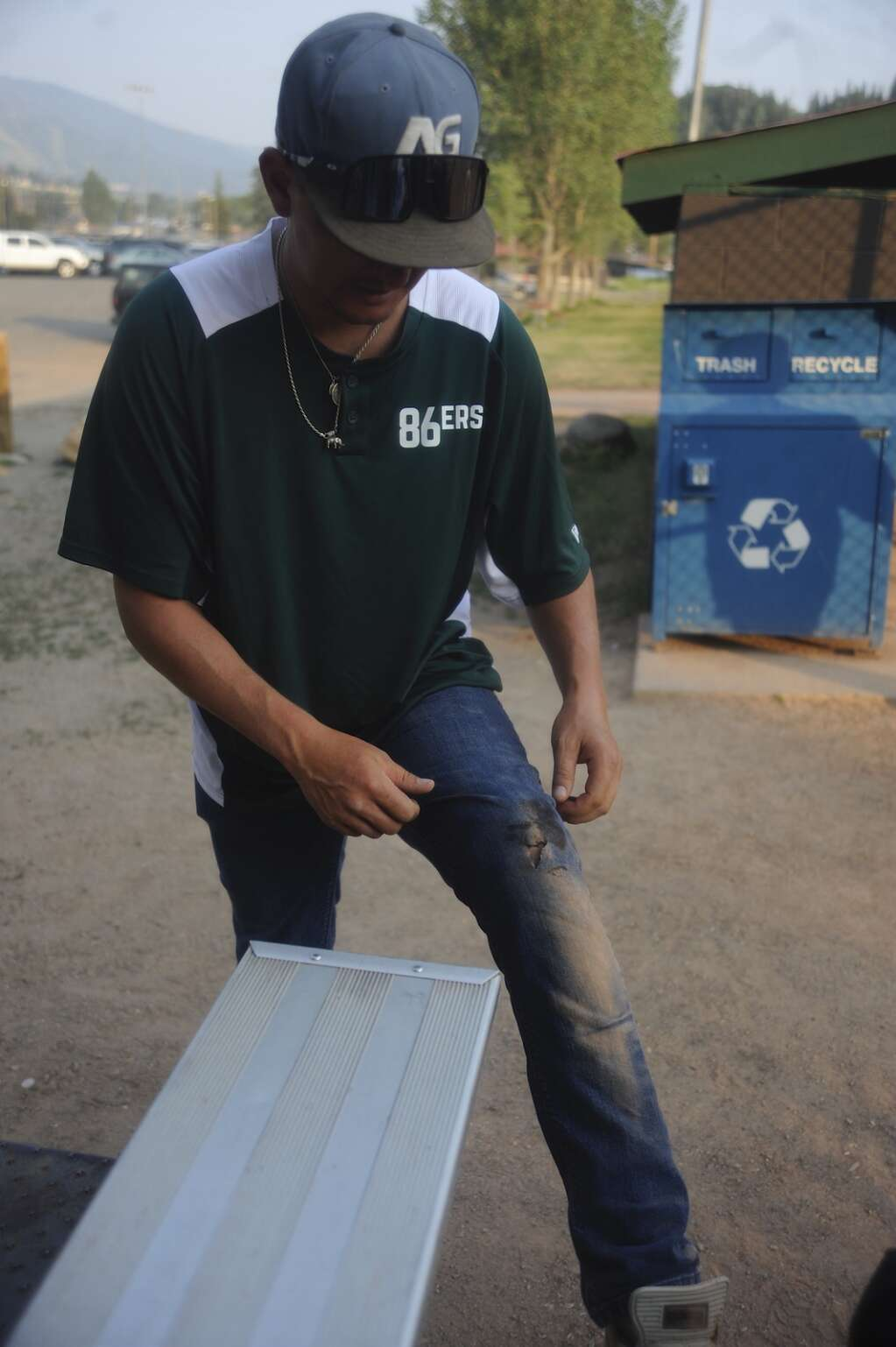 Chad Oliver of The 86ers decided to wear jeans to Monday night's men's league softball game. He tore them early on while sliding. The 86ers are a self-proclaimed band of misfits and have been around for about 10 years. (Photo by Shelby Reardon)