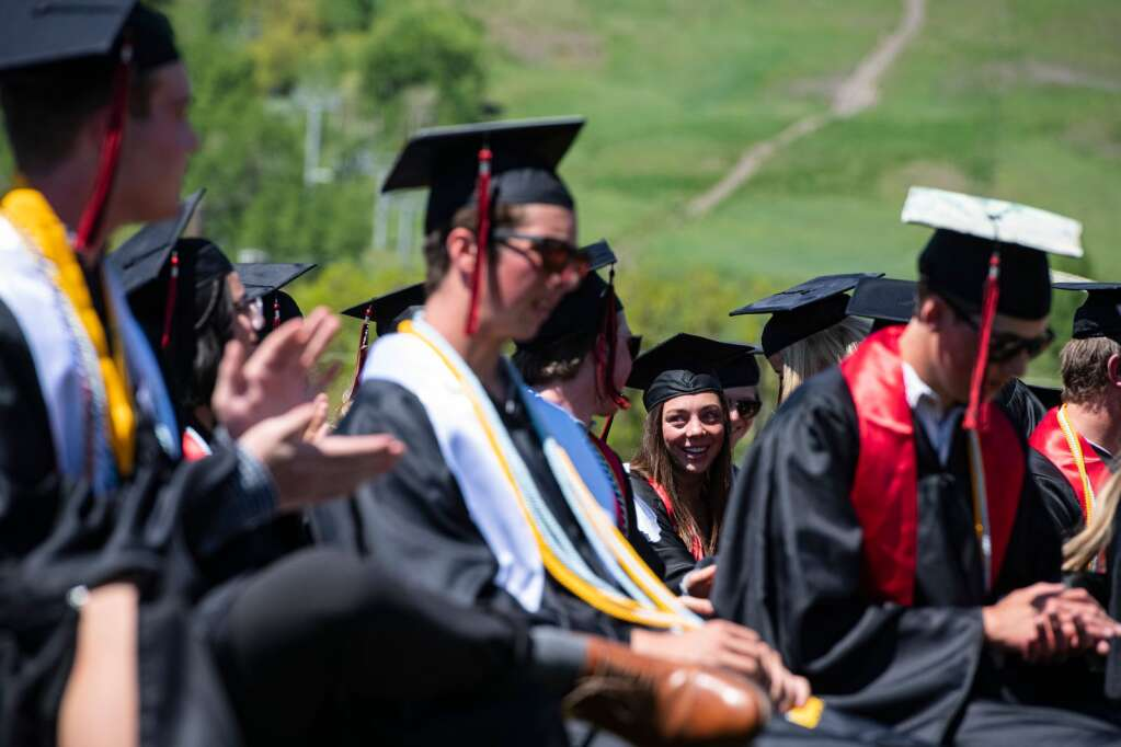Classmates applaud graduate Evelyn Leibinger after listening to her rendition of Billy Joel's 'Vienna' during the commencement ceremony on Saturday, June 5, 2021. (Kelsey Brunner/The Aspen Times)