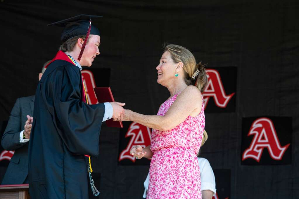 As Aspen High School graduate gets his diploma from his mom during the commencement ceremony at the school on Saturday, June 5, 2021. (Kelsey Brunner/The Aspen Times)