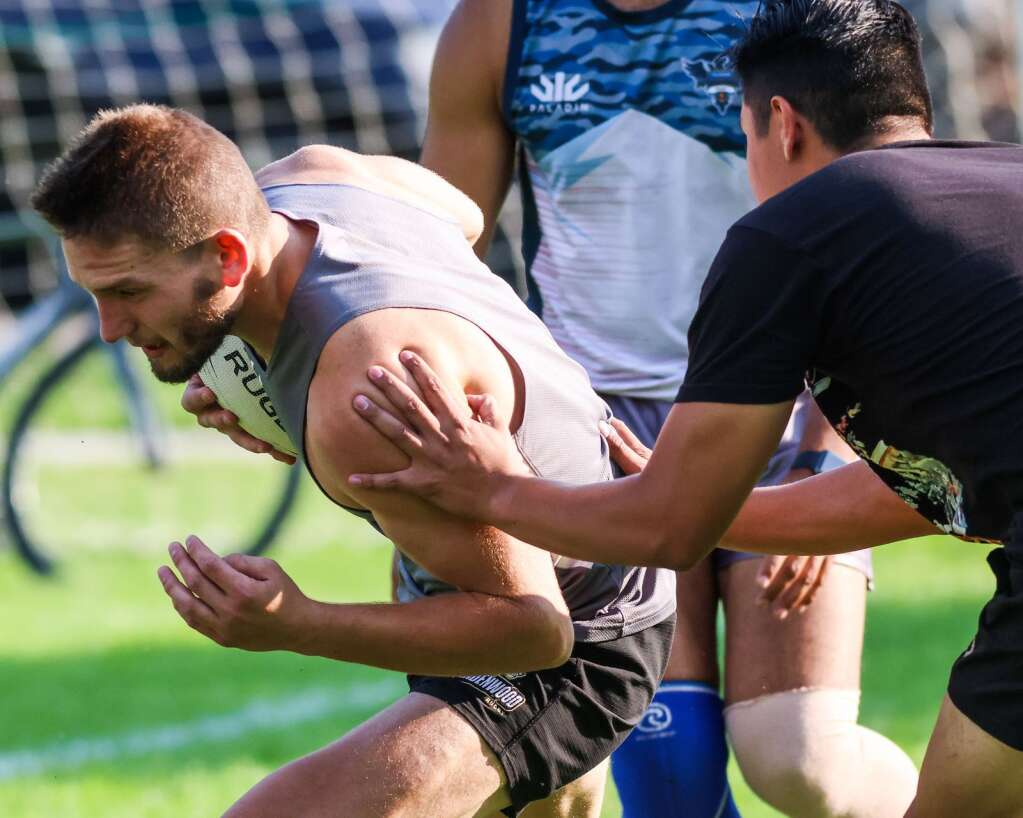 The Gentlemen of Aspen Rugby Club plays a game of touch ahead of the main drills during practice on Thursday, July 15, 2021, at Rio Grande Park in Aspen. Photo by Austin Colbert/The Aspen Times.