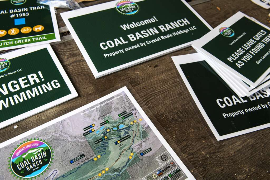 Permanent signage for Coal Basin Ranch sits in the barn to prepare to be placed around the property for the community trail system in Redstone on Thursday, July 29, 2021. (Kelsey Brunner/The Aspen Times)