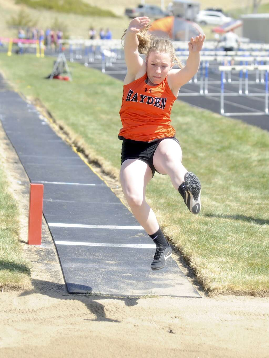 A Hayden athlete competes in long jump at the Clint Wells Invitational in Craig on Friday. (Photo by Shelby Reardon)