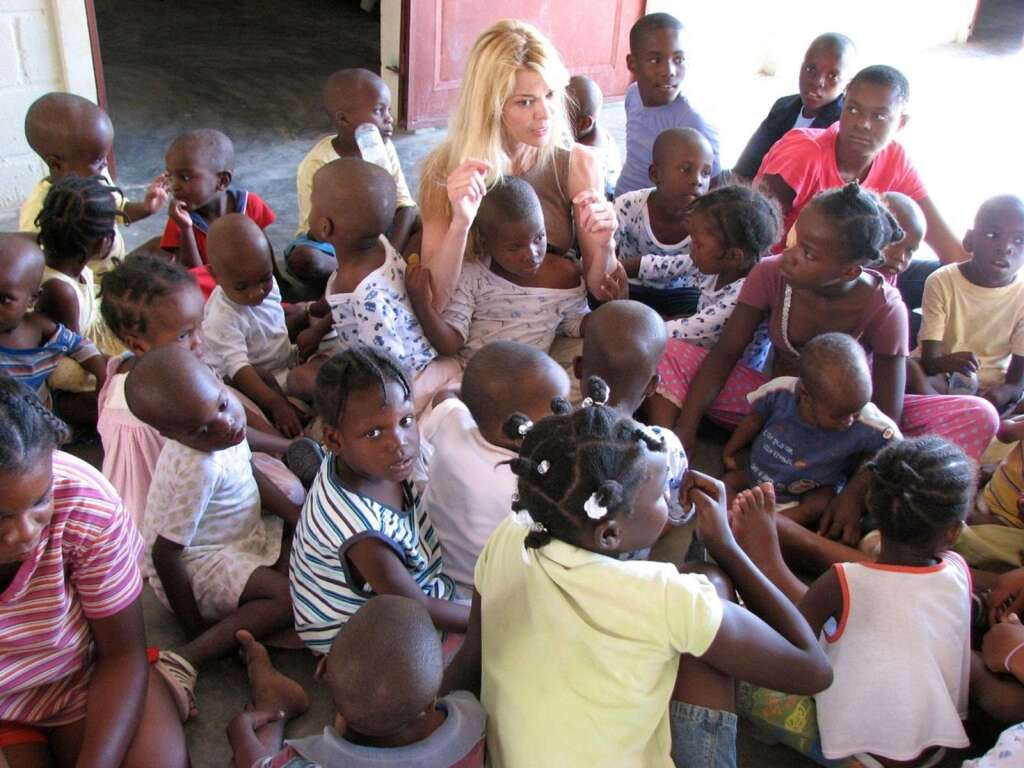 Susie Krabacher explaining to the orphans they are now safe and moving to a new home after the 2010 earthquake in Haiti.