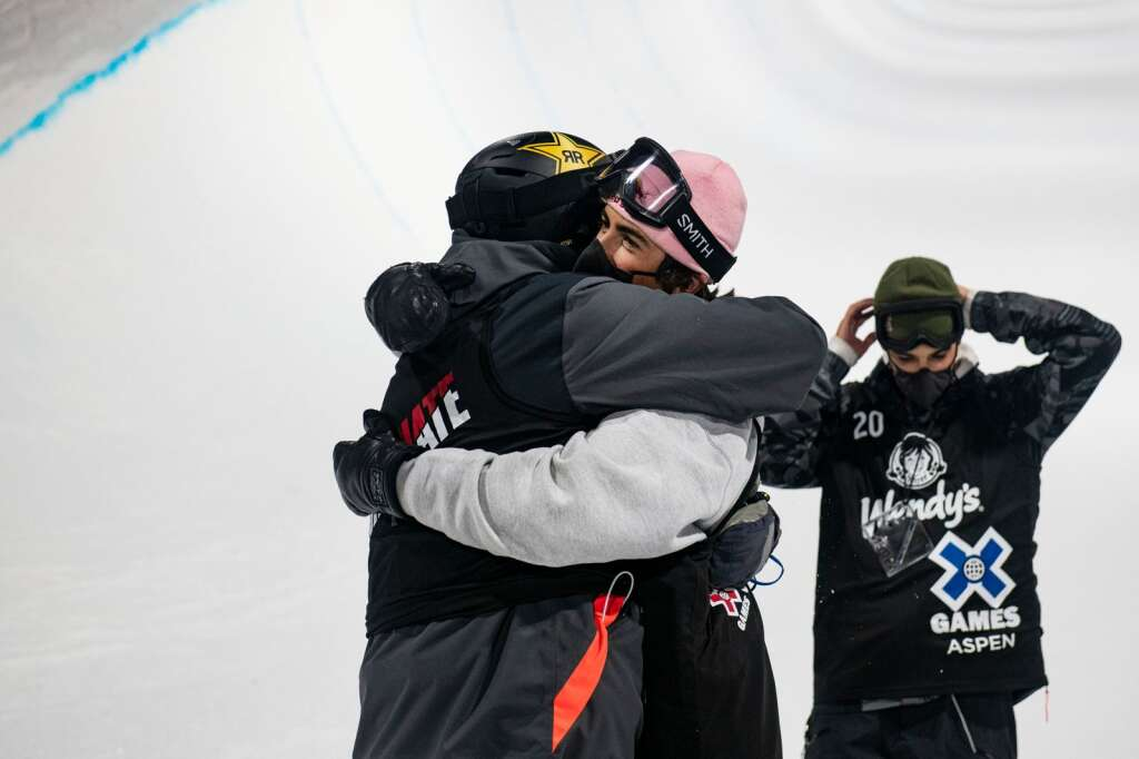 Aaron Blunck and Birk Irving share a moment at the bottom of the superpipe after both freestyle skiers medaled during the finals at the 2021 X Games Aspen at Buttermilk on Friday, Jan. 29, 2021. (Kelsey Brunner/The Aspen Times)