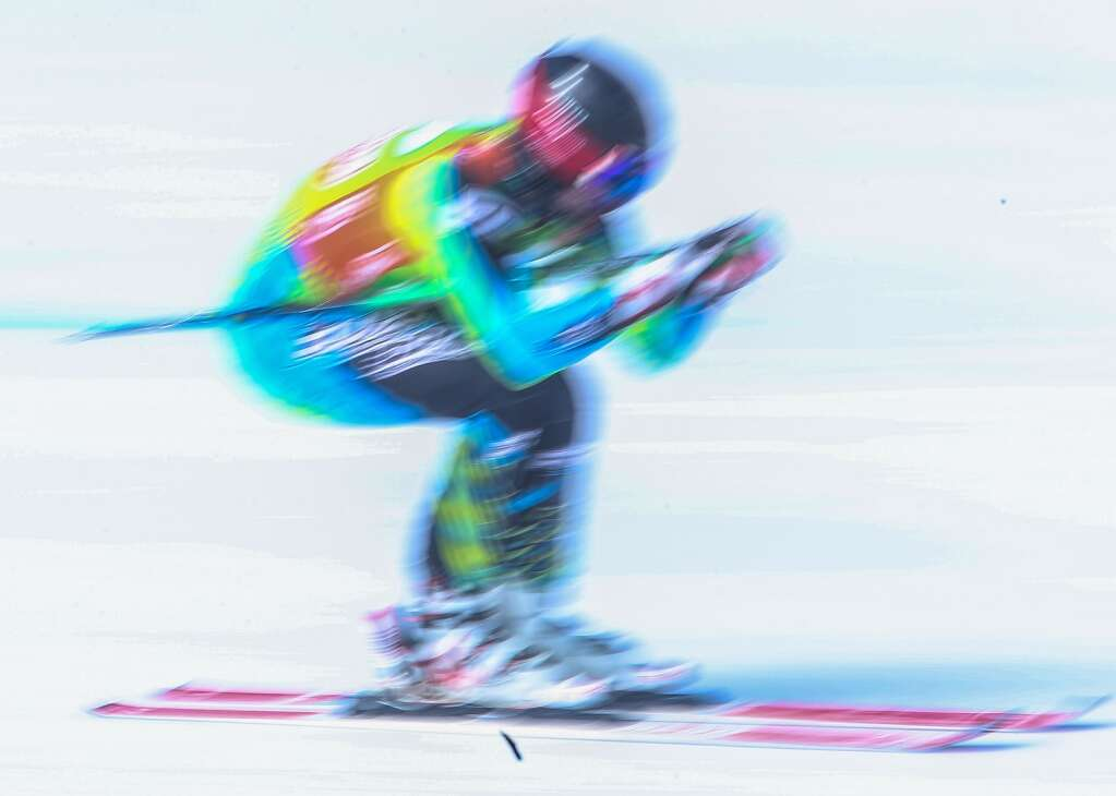 A ski racer speeds through the giant slalom course at NASTAR national championships on April 7, 2021, at Snowmass Ski Area. | Austin Colbert/The Aspen Times.