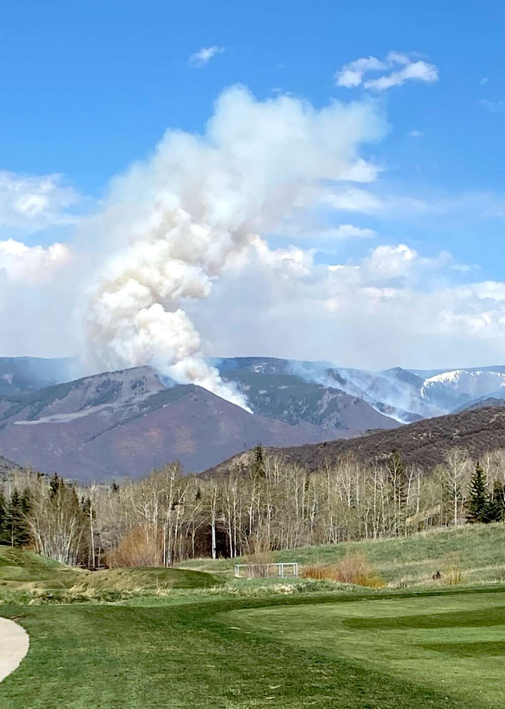 Smoke rises from the Collins Creek prescribed fire north of Aspen as seen from the Snowmass Village Golf Course on Friday, May 7, 2021. | David Krause/The Aspen Times