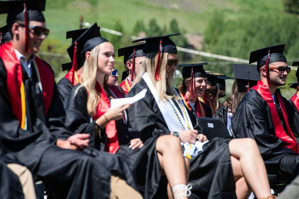 Aspen High School graduates laugh along with the valedictorian speech during the commencement ceremony on Saturday, June 5, 2021. (Kelsey Brunner/The Aspen Times)