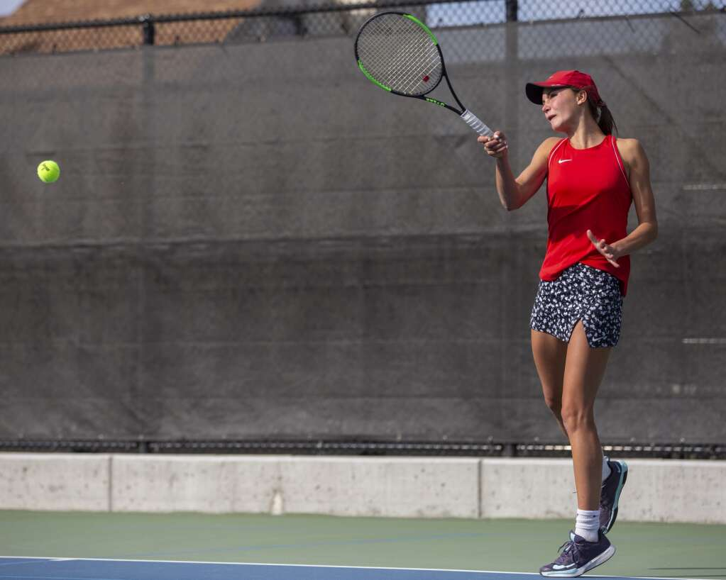 Park City High School sophomore third singles player Reagan Harrison returns a volley on court 9 during her third singles matchup against Murray High School at the PC MARC Thursday afternoon, Sept. 23, 2021. (Tanzi Propst/Park Record)