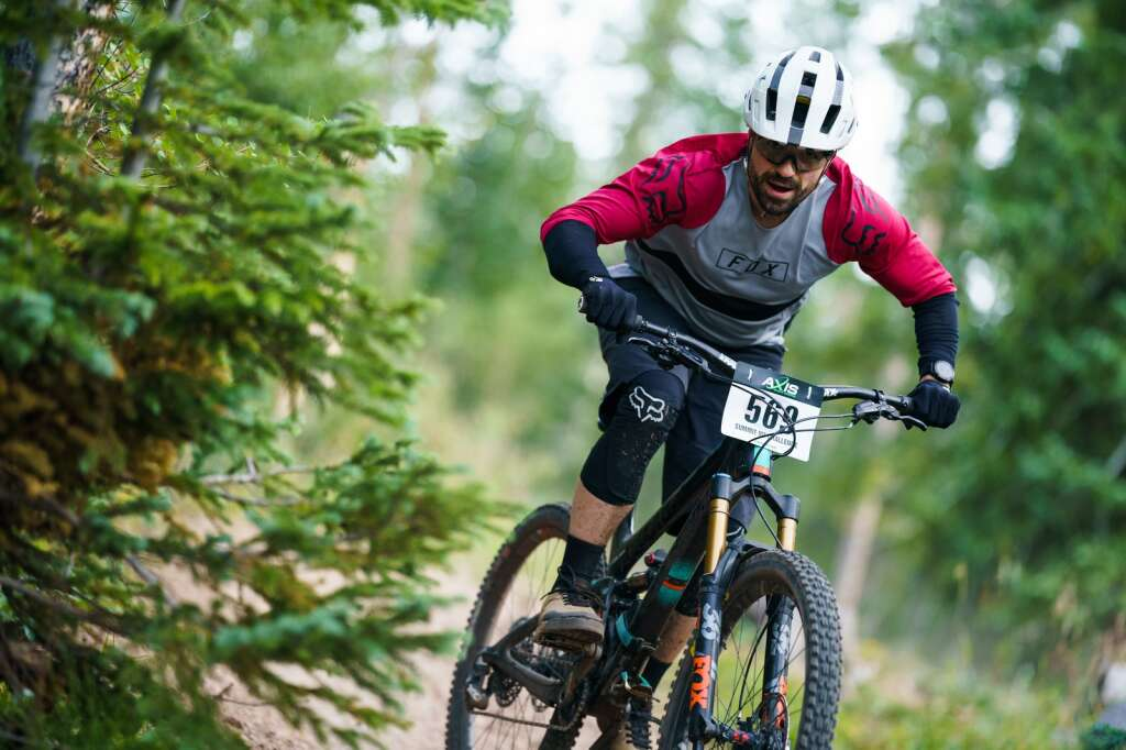 Shandy Sawyer sends the Peaks Trail while riding the big bike open class, a category designed for riders choosing to race bikes with longer suspension travel than may be ridden in a typical cross country race, at the Peaks Trail Time Trial mountain bike race. | Photo by John Hanson